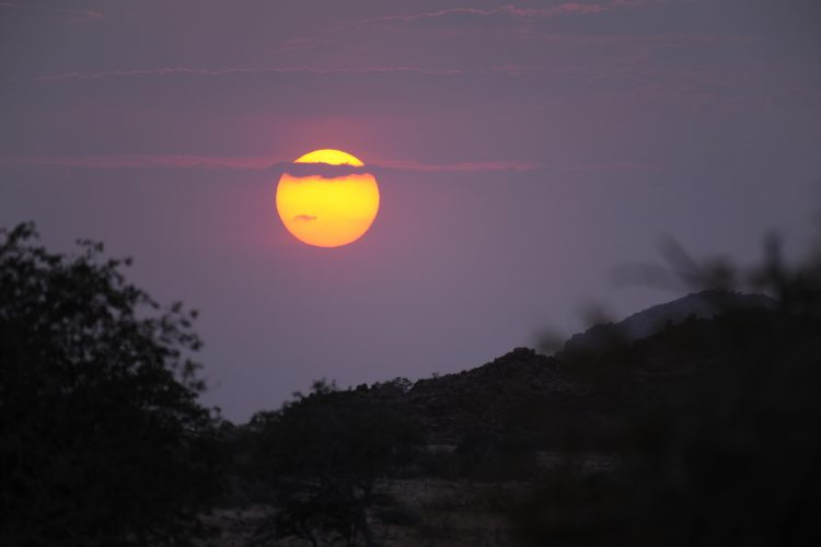 Sunset over the Ugab river at Desert elephant project in Namibia