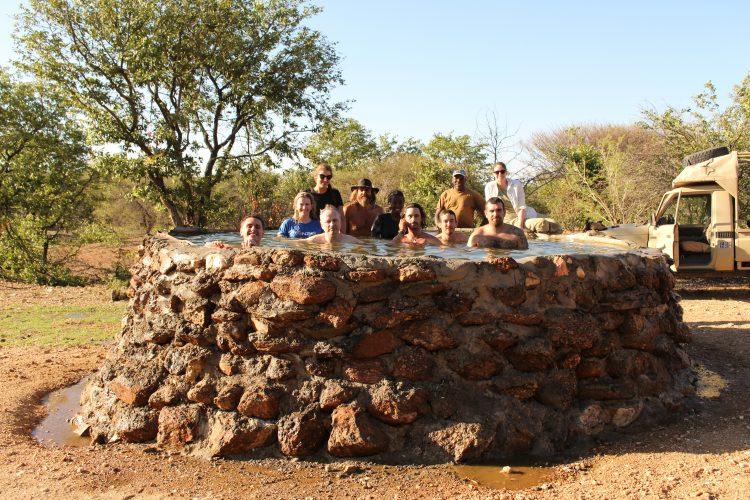 Volunteers cooling off in pool in Namibia