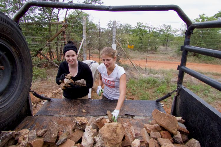 Volunteers helping to build a fence in Botswana