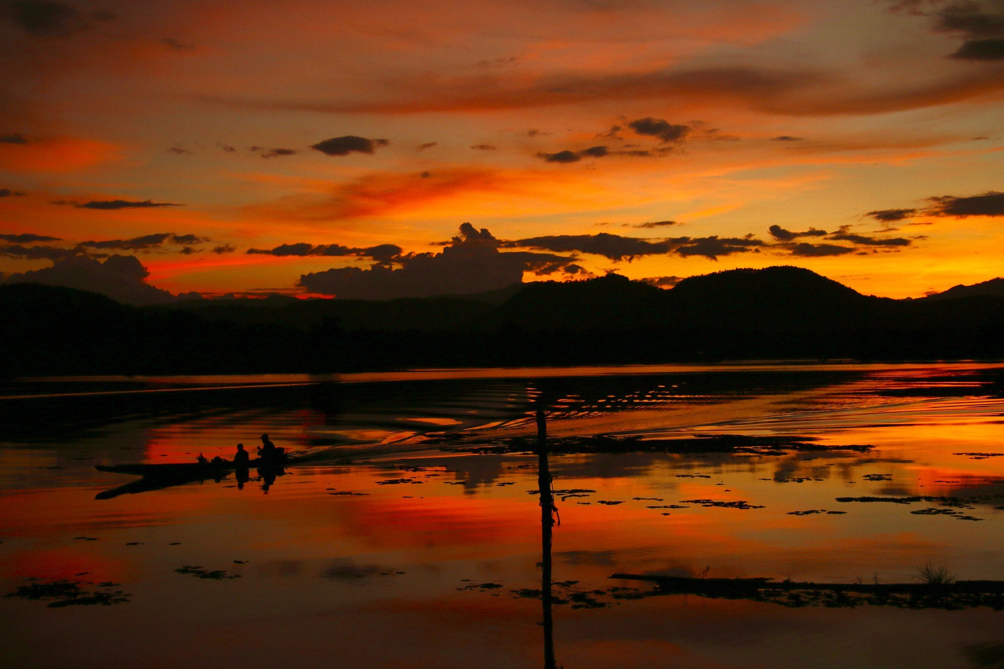 Sunset by river in Laos