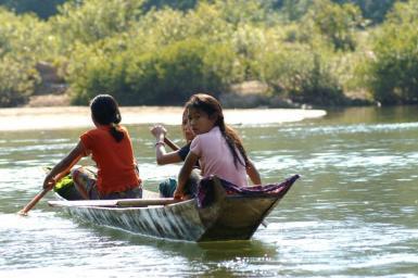 Women in boat on river in Laos