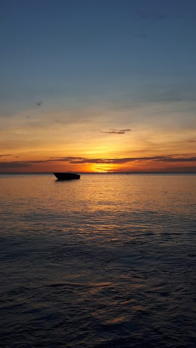 Boat on the water at sunset in Carriacou