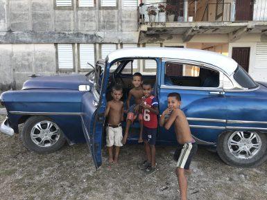 Children in car in Cuba