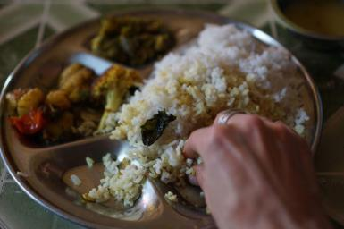 Eating a rice meal
