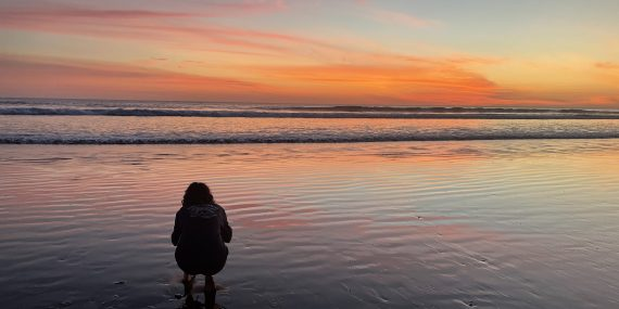 Volunteer admiring Costa Rica sunset at Olive Ridley project